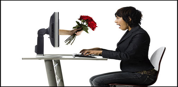 woman doing online dating handed flowers