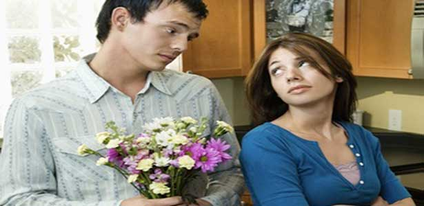 man tells her sorry with flowers