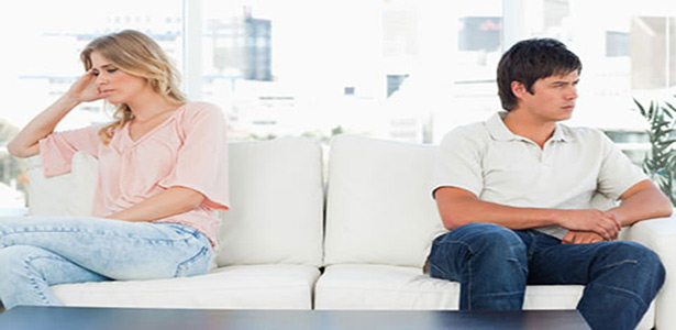 Man and woman sitting at opposite ends of couch because its not about you