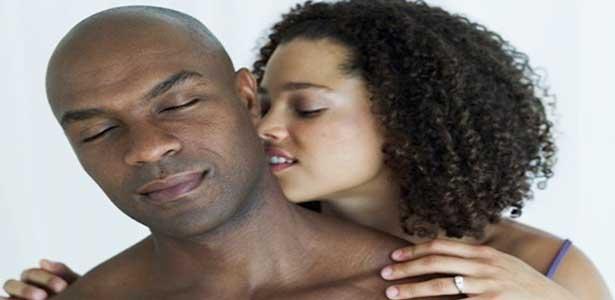 black woman kissing man on head