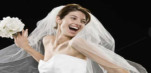 not in love woman smiling in wedding dress